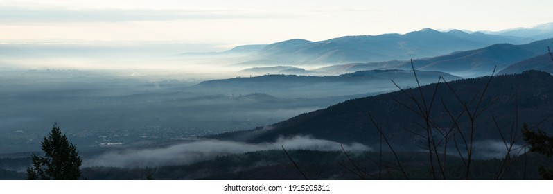 Panorama view on the Vosges massif with mist in winter from Haut-Koenigsbourg castle in France