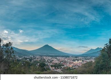 The panorama view over Antigua Guatemala. You can se Volcan de Agua, Volcan Acatenango and erupting Volcan de Fuego.
