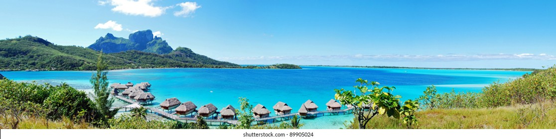 Panorama view of over water bungalow in Bora Bora , the famous island of French Polynesia , south Pacific .