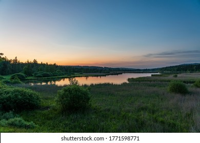 """Panorama view of """"Padrtske rybniky"""" in Brdy, the Czech Republic. Beautiful calm pond with sunset."""