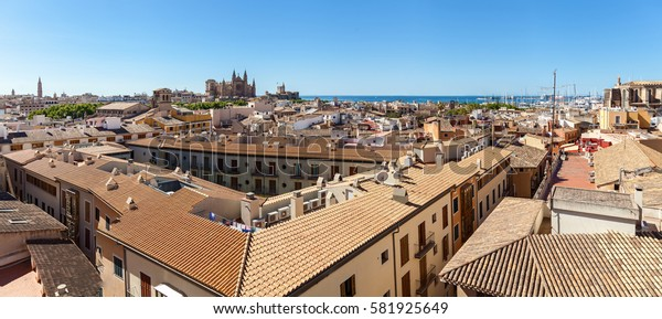 Panorama View of Palma de Mallorca. Wiew of Palma de Mallorca from the roof of one of the houses of the seaside town. In the distance you can see tMaria in the background of the azure sea