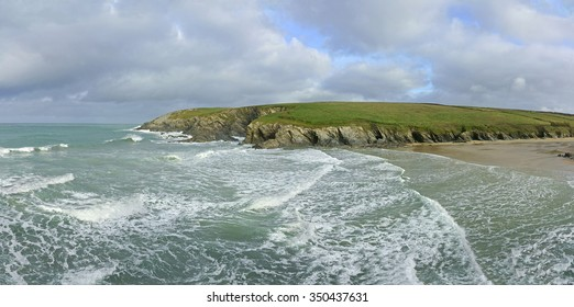 A panorama view of Porth Joke cove and beach showing an incoming tide in winter time near Newquay and on the South West Coastal Path, Cornwall, England, United Kingdom