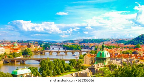 Panorama view of Prague skyline with Charles bridge and Vltava river in the late afternoon summer