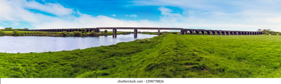 A panorama view from the River Trent levy of the abandoned railway viaduct at Fledborough, Nottinghamshire in springtime