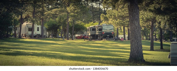 Panorama view RV campground with plenty of trees for both tent camping and RV sites in Texas, America