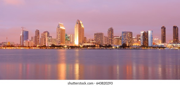 Panorama view of San Diego Skyline After Sunset. Photo Showing Downtown viewing from Centennial Park.  San Diego is on the coast of the Pacific Ocean in Southern California, USA.