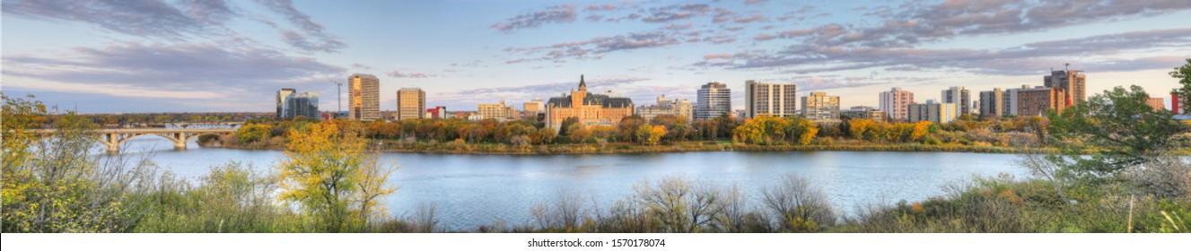 A Panorama view of Saskatoon, Canada cityscape over river