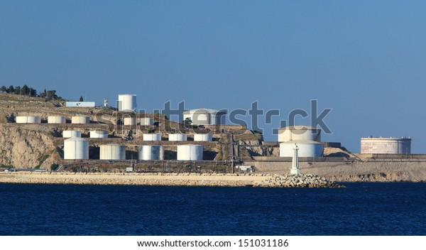 Panorama view of sea with oil tanks