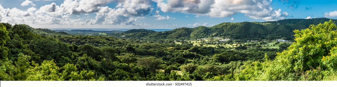 Panorama View of St. Croix Countryside with small village at the base of the hills and ocean in the background