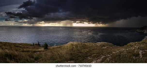 Panorama View of a Storm coming on the ocean ,Storm clouds on the horizon, the beginning of the storm.