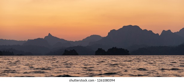 panorama view of sunset in the mountains and sea