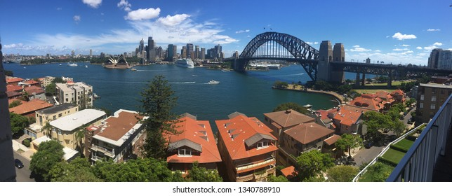 Panorama view of Sydney Harbour taken from Kirribilli, including Sydney Harbour Bridge, the Sydney Opera House, circular quay, Summer day