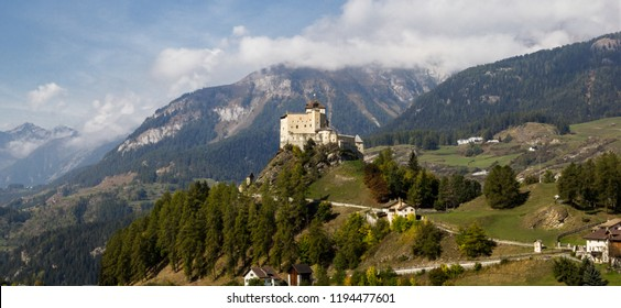 Panorama view of Tarasp valley with Tarasp castle (built in the 11th century) in Swiss Alps, Canton Grisons or Graubuendon, Switzerland (large stitched file)