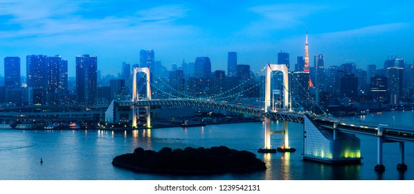 panorama  view of Tokyo Tower skyline and Rainbow Bridge with cityscape at Odaiba Japan