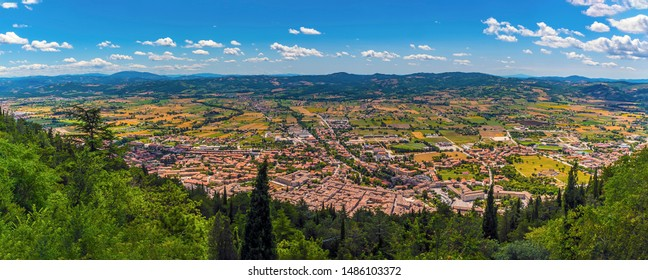 A panorama view from the top of the Colle Eletto cable car over the city of Gubbio, Italy towards the Apennine mountains in summer