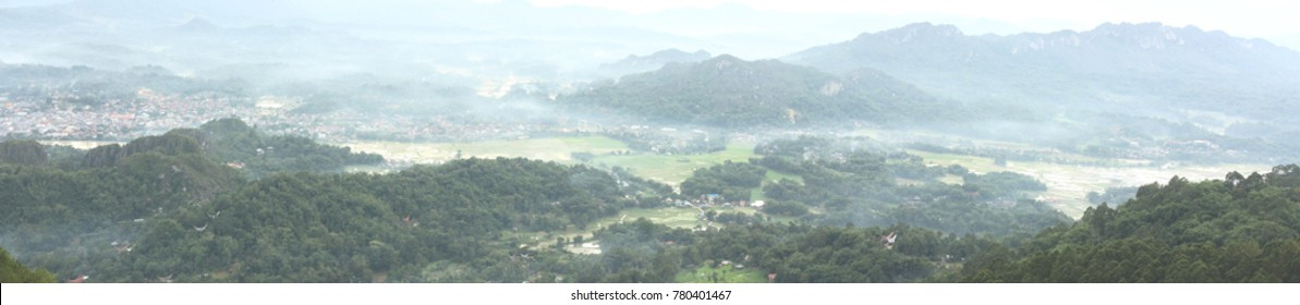 "Panorama view of Toraja. Photo taken from nearby higher ground called ""Lolai, a place above the cloud""."