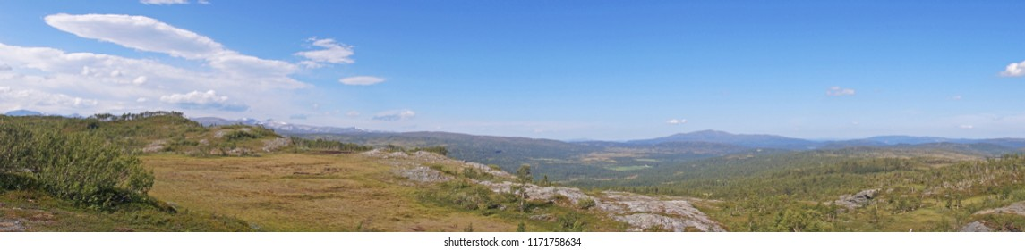 Panorama view towards beautiful nature with small mountains seen in Nerskogen, Norway