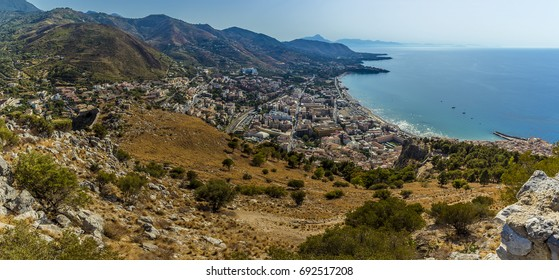 A panorama view of the town of Cefalu, Sicily from the ramparts of the Norman castle atop the mesa behind the town in summer
