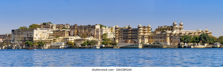 panorama view of Udaipur's city palace from the lake.