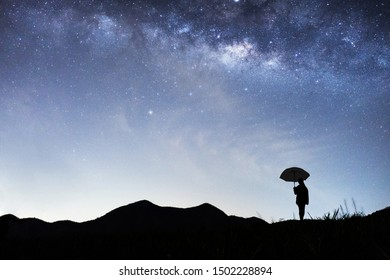 Panorama view of universe space shot of nebula and milky way galaxy with stars on blue night sky . Milky way galaxy with hill under amazing starry night sky. Silhouette of Mountain and skyline