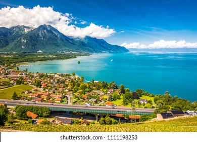Panorama view of Villeneuve city with Swiss Alps, lake Geneva and vineyard on Lavaux region, Canton Vaud, Switzerland, Europe.