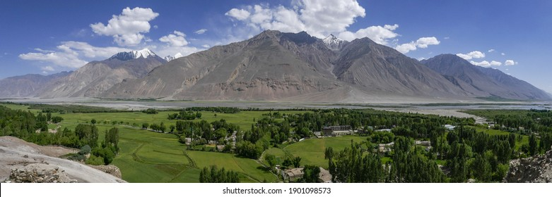Panorama view of the Wakhan Corridor in the Tajikistan Pamir mountains looking towards the Hindu Kuch range in Afghanistan on other side of Panj river - Shutterstock ID 1901098573