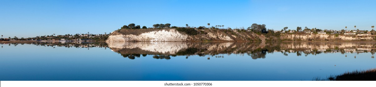 Panorama view of west cliffs at the back bay in Newport Beach California at high tide