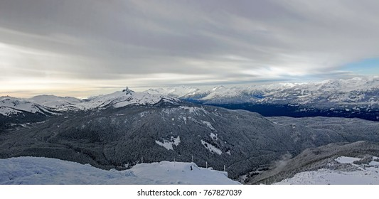 Panorama view from Whistler Mountain Peak with rare clear skies and Black Tusk Mountain visible in Garibaldi Provincial Park.
