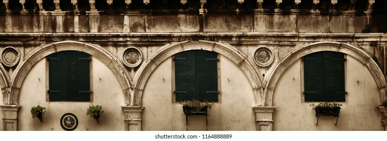 A panorama view of window in historical buildings in Venice, Italy.