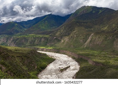 Panorama view of Yarlung Tsangpo (Yarlung Zangbo) Grand Canyon , Brahmaputra Canyon or Tsangpo Gorge and Yarlung Tsangpo River in summer wit blue sky cloud, Tibet, China