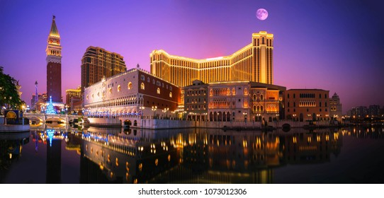 Panorama viewpoint urban landscape twilight night traffic with full moon in Macau