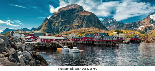 Panorama of A - village, Moskenes, on the Lofoten in northern Norway. Norwegian fishing village, with the typical rorbu houses.  Mountain In Background