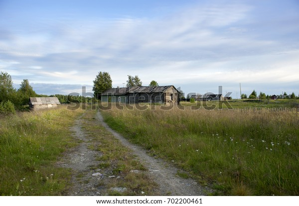 Panorama village with wooden houses with road and green grass. Russia, Karelia