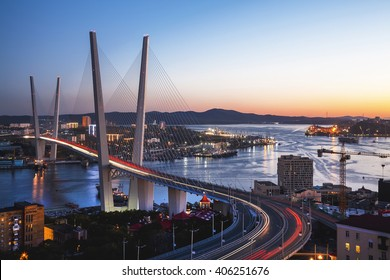 Panorama of Vladivostok at sunset, Far East Russia. Golden bridge.