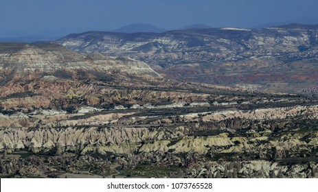 Panorama of the volcanic landscape of Cappadocia, Turkey. / Cappadocia is a historical region in Central Anatolia. The region is home to one of the most spectacular landscape