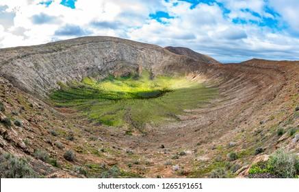 Panorama volcanic landscape of green Caldera Blanca volcano crater in Lanzarote, Canary Islands, Spain.