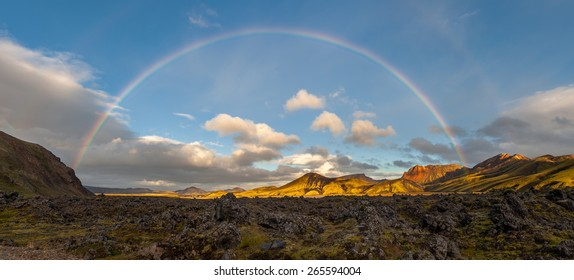 Panorama of volcanic landscape under a full rainbow, Landmannalaugar, Iceland