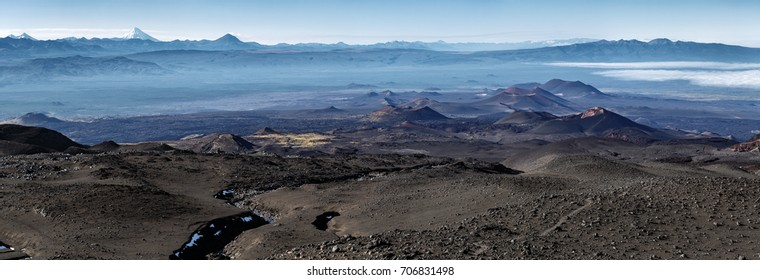 Panorama volcano landscape of Kamchatka Peninsula: series of cinder cones and lava fields of fissure eruptions Plosky Tolbachik Volcano. Russian Far East, Kamchatka, Klyuchevskaya Group of Volcanoes.