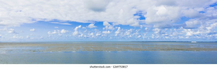 Panorama Wadden Sea (Waddenzee), The Netherlands. Unsecco world heritage site. Water, clouds, sandbank, Dutch sky.