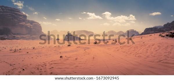 Panorama of the Wadi Rum desert in Jordan during a slight sand storm