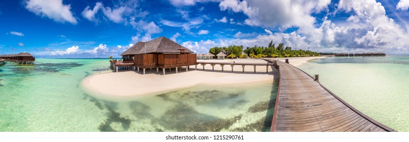 Panorama of Water Villas (Bungalows) at Tropical beach in the Maldives at summer day