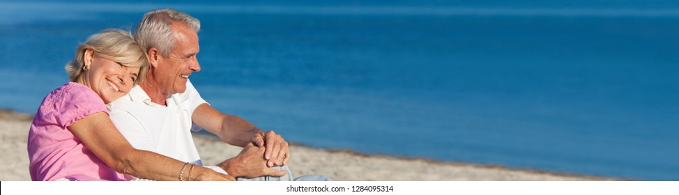 Panorama web banner happy romantic senior man and woman couple together on a deserted beach