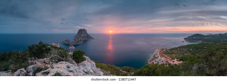 Panorama from the west side of Ibiza Island at sunset with Savinar watchtower and Es Vedra island .