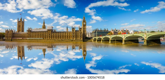 Panorama of Westminster bridge and Big Ben with reflection in the water