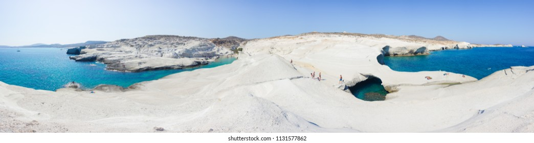 Panorama of white chalk cliffs in Sarakiniko, Milos island, Cyclades, Greece on July 10, 2018.