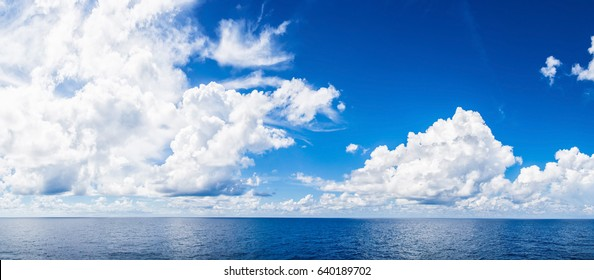 Panorama of white cloud and blue sky with sea.