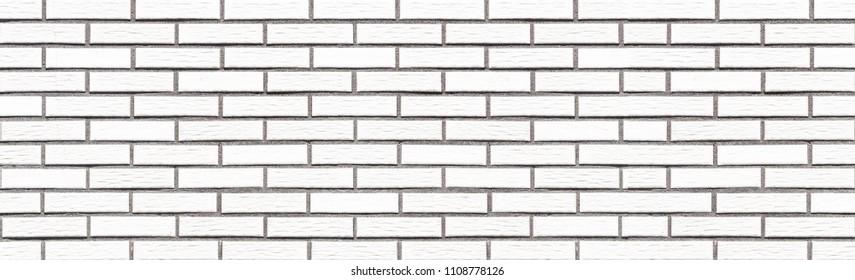 Panorama of White stone brick wall tile background seamless