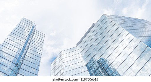 Panorama wide look up view of modern skyscrapers glass building with cloud reflection