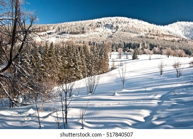 panorama of winter Moravskoslezske Beskydy mountain range with Luksinec and Lysa hora hills, lot of snow and clear sky from Butoranka near Ostravice in Czech republic