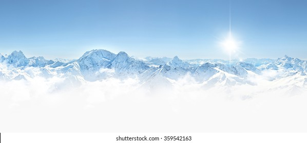 Panorama of winter mountains in Caucasus region,Elbrus mountain, Russia, with sun and copy space